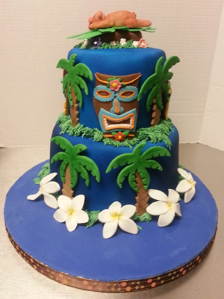 Tiki cake is for our luau themed Family Reunion 2012.  Cake inspired by Pink Cake Box.  Tiki designs are my own and hand made and cut myself.  First time making pig (you can tell).  Cake is covered in white fondant and sprayed blue.