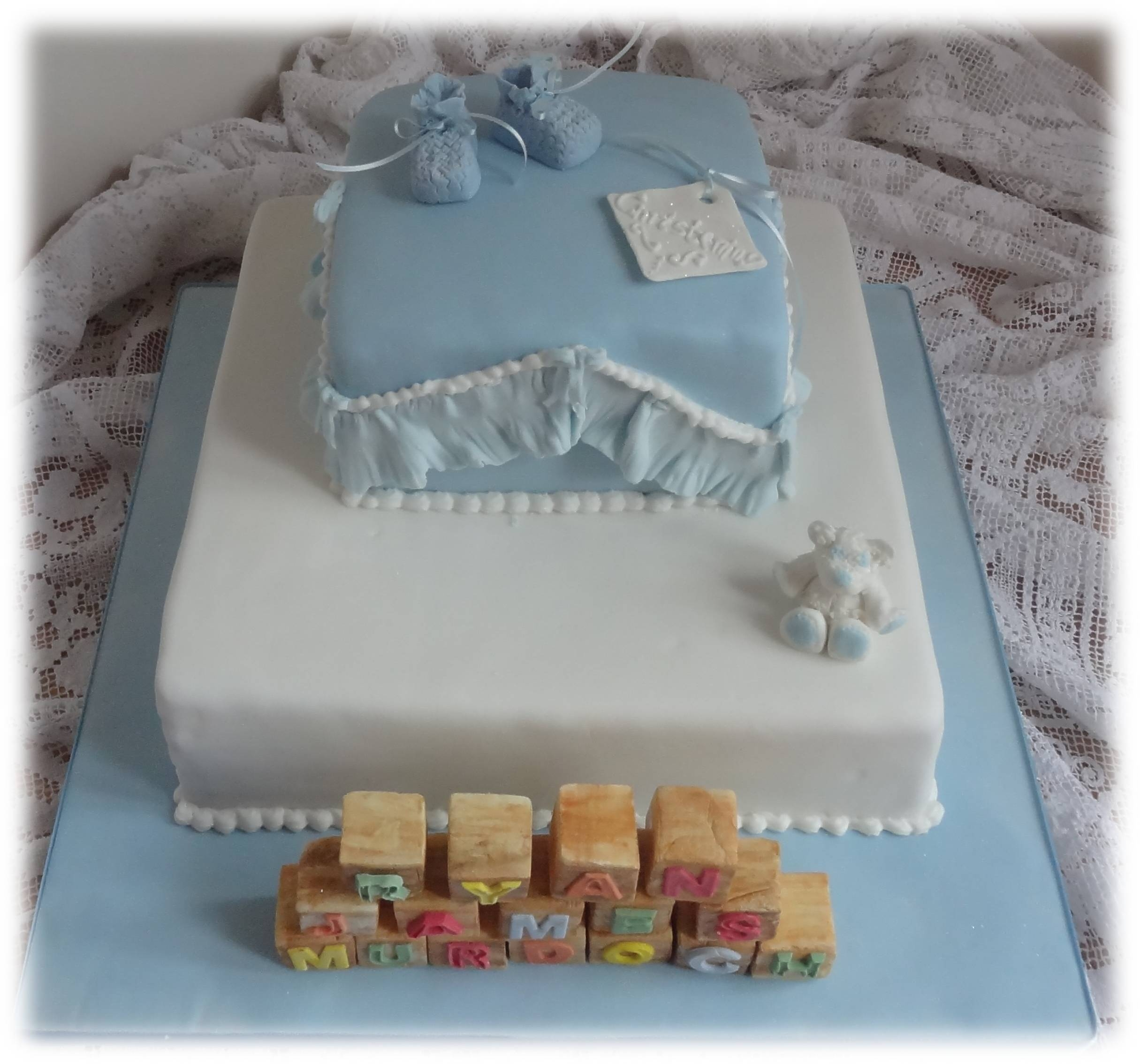 This lady wanted a plain cake with simple 'wooden' block lettering decorations and 'woollen' booties. I added the little teddy because I thought the first tier looked a little empty. I opted for real ribbon in the booties as icing ones snap easily which is not ideal if she wanted to keep them. Chocolate fudge cake and victoria sponge. All decorations made with home made sugarpaste.