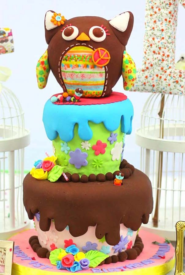Handpainted gumpaste owl tops two tiered cutesy cake