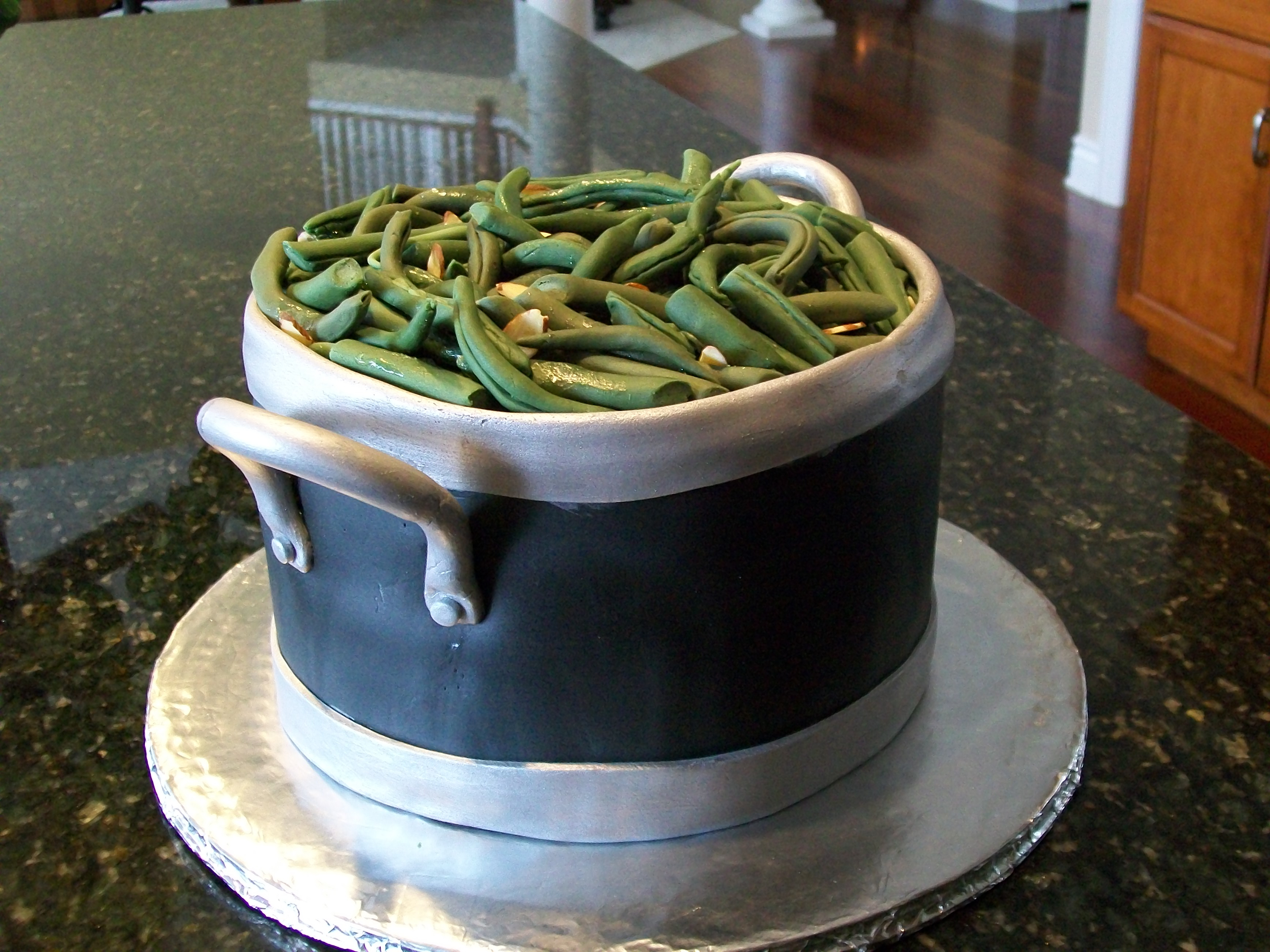 "Made this for a friends birthday.  Cake is three 8"" layers of chocolate-chocolate chip. Green beans are fondant but sliced almonds are real.  Thank you Vicki09 for the inspiration."
