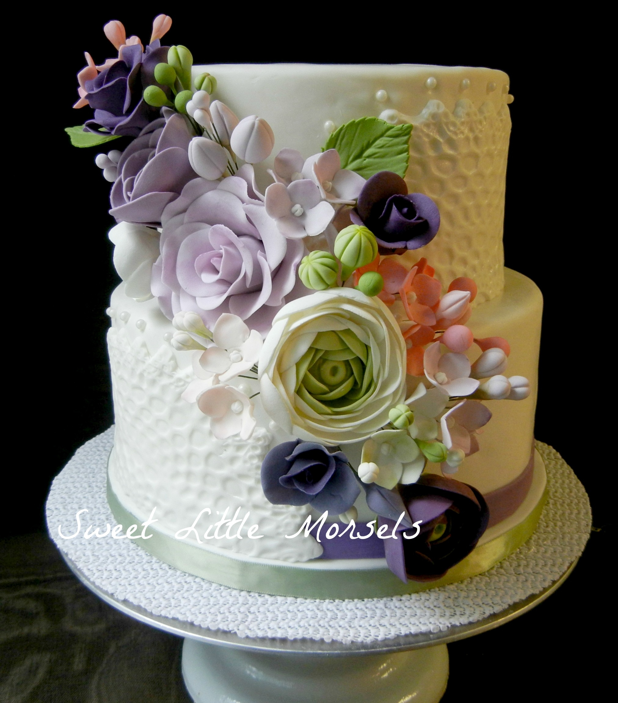 This was a cake I did a little over a month ago for a bridal shower. The colors were, purple, pink and green. All the sugar flowers were handmade by me, which took me about 4 days to complete. I had a lot left over which was nice. Love how it turned out.