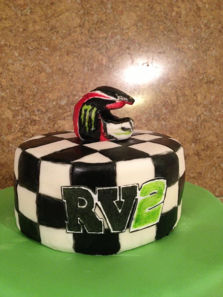 Ryan Villopoto supercross cake for a friends sons birthday.  Helmet was made with gumpaste and colored with edible marker and food coloring.  Other details done with sugar paper and edible markers