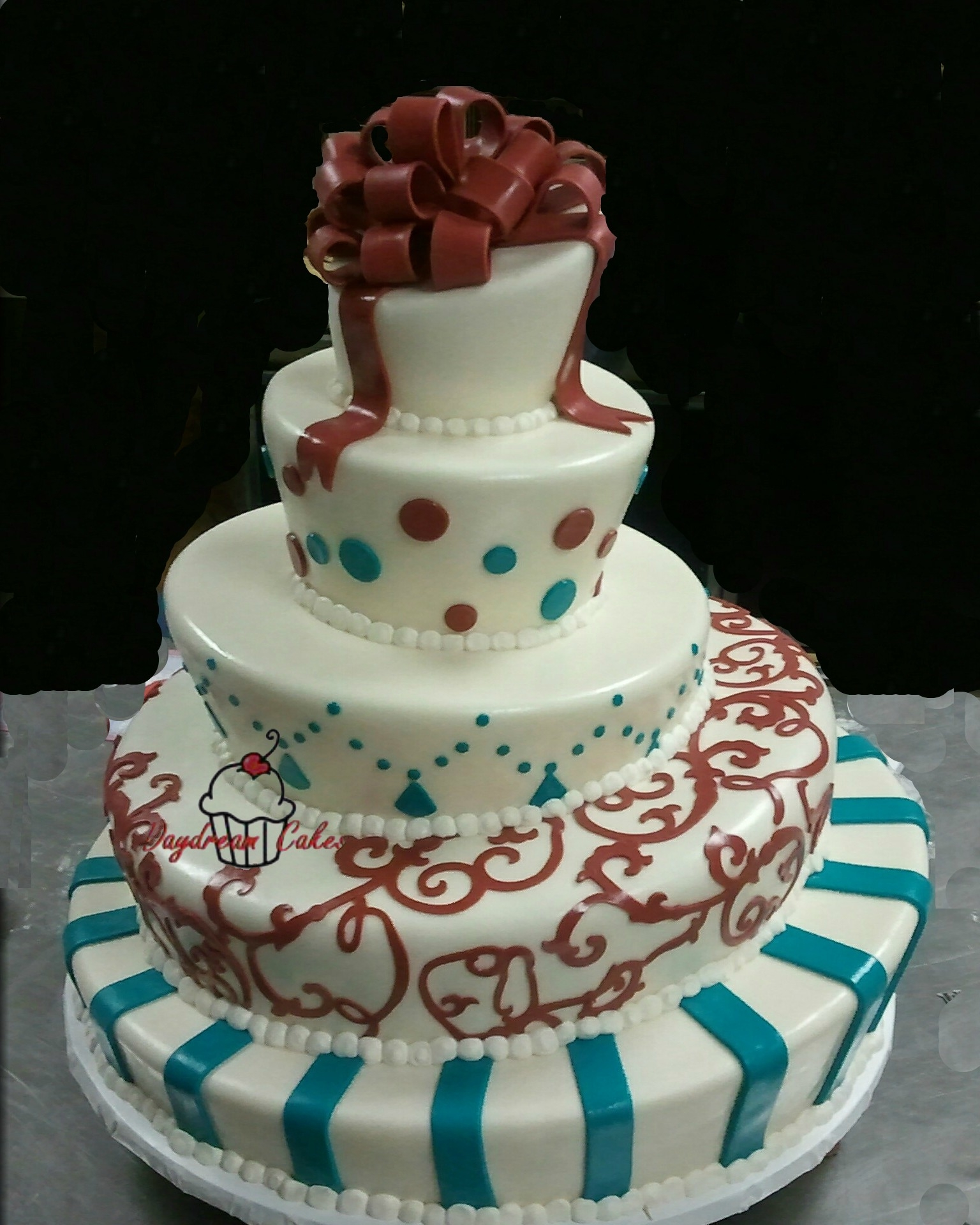 Topsy Turvy Wedding Cake..Didn't get a good photo, the bride will provide one later