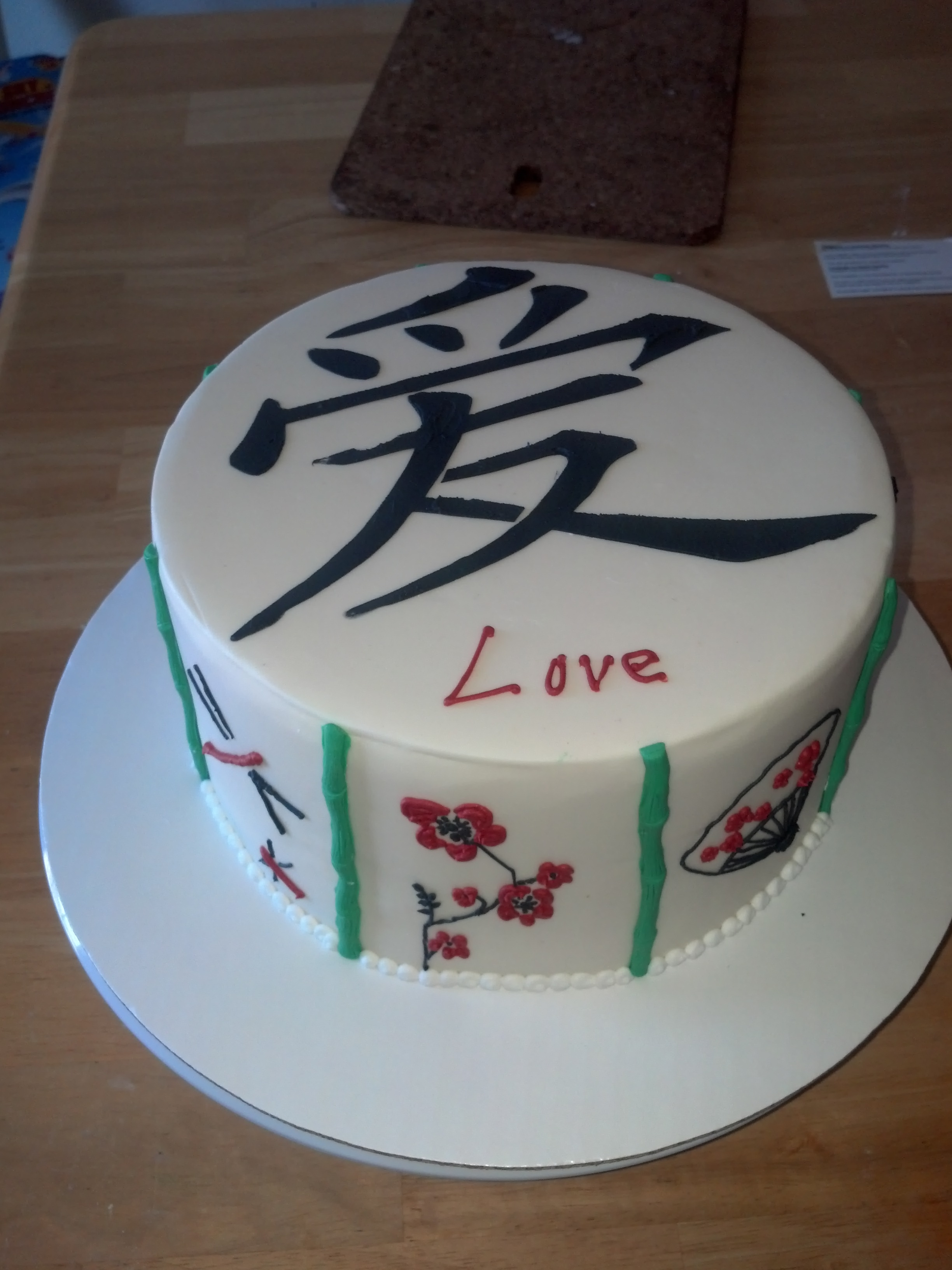 Fondant covered cake with stenciled Chinese 'love', molded bamboo, everything else is hand piped