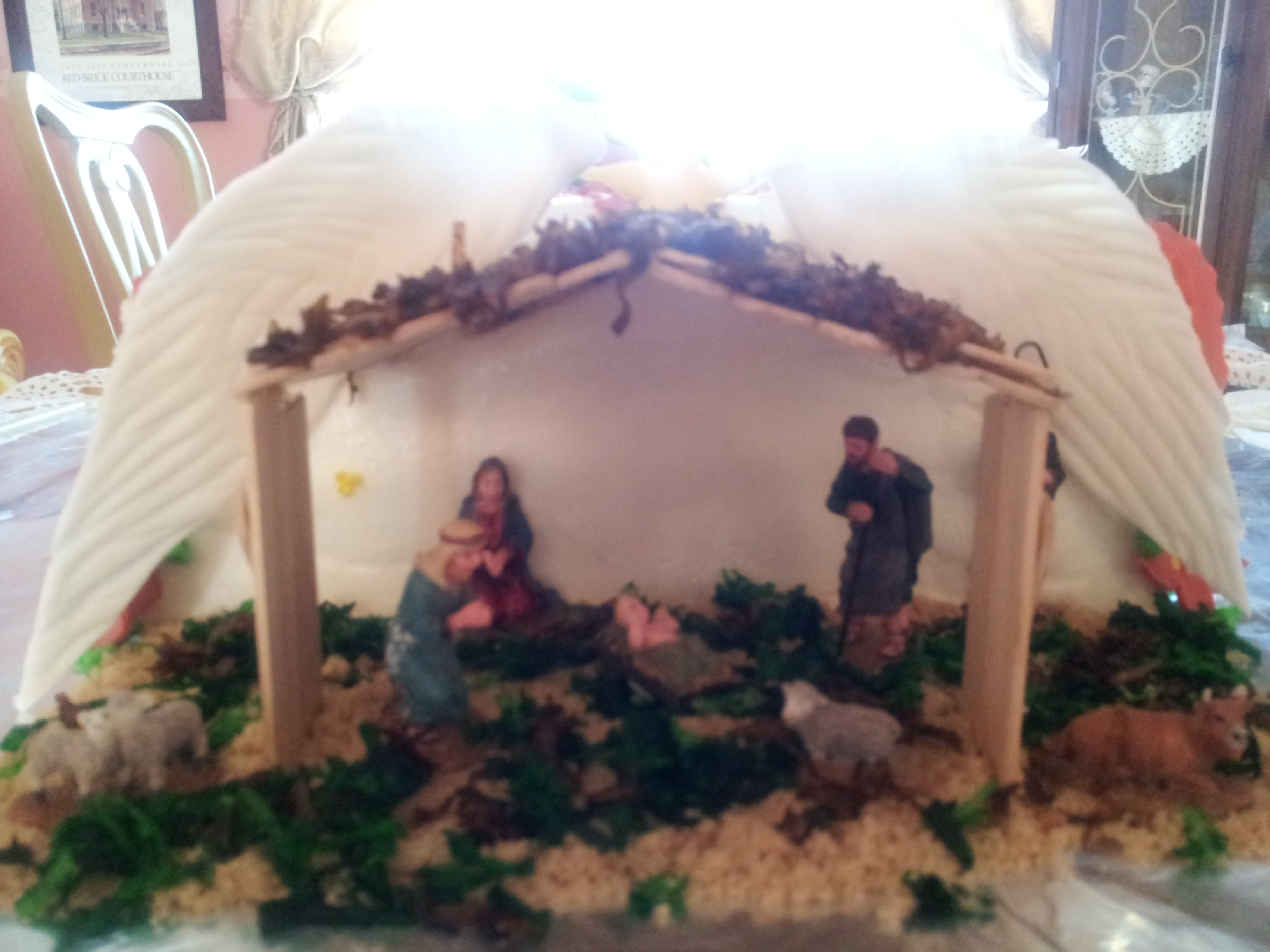 It is a nativity coming out of a gift box