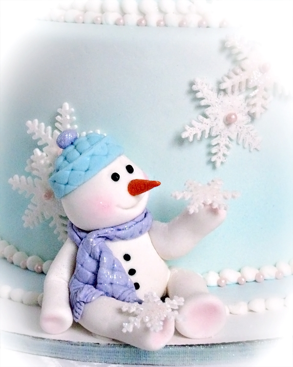 First Birthday Cake with a winter wonderland snowman style theme