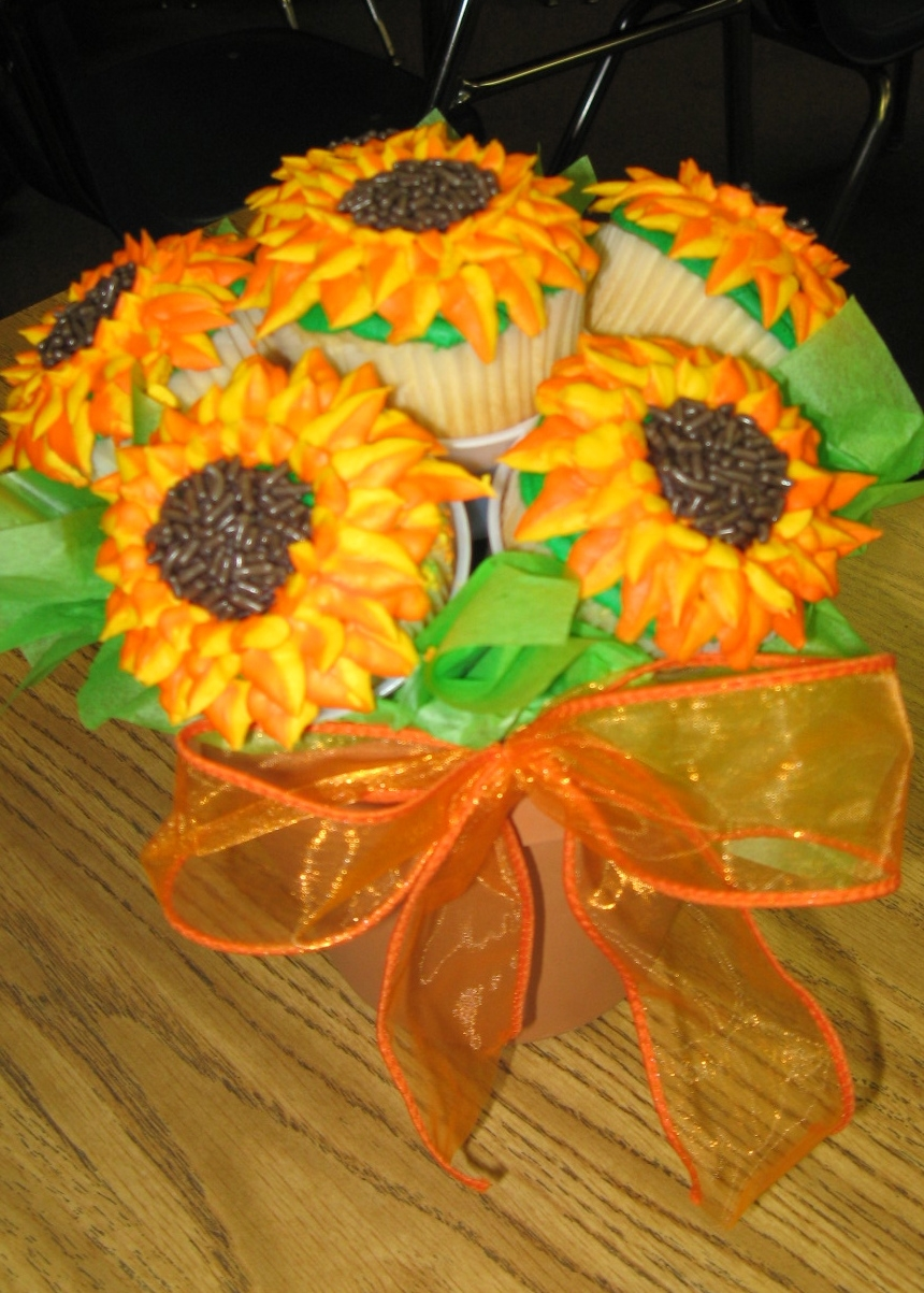 This is a picture of one of the sunflower cupcake bouquets that my middle school Cake Club students made.  They loved them and had so much fun making them!
