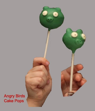 These cake pops were made with chocolate cake, green candy melts, white mini chips and edible writing pens. Please disregard the tiny hands - this was one photo of my nephews holding their angry birds pops and i cropped out their faces/bodies