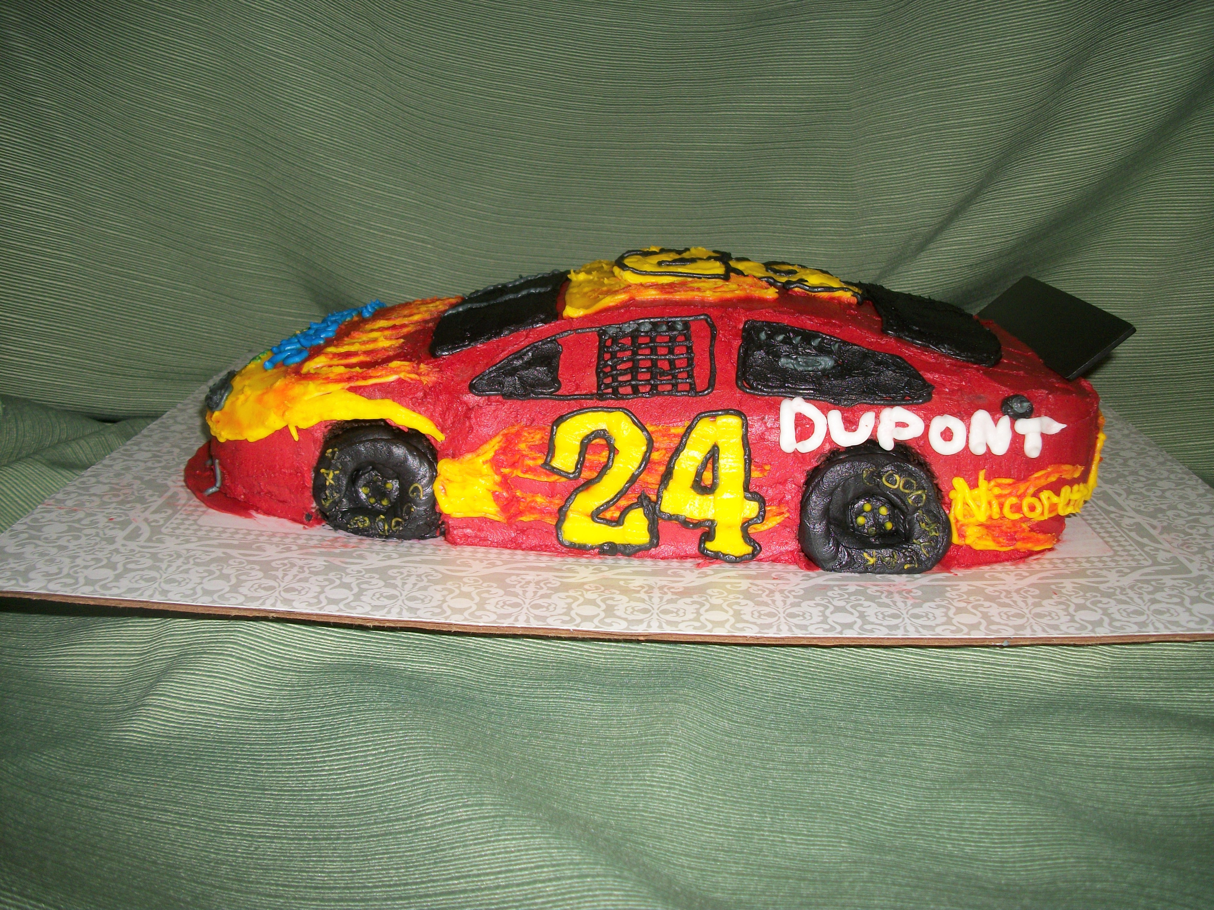 This is a sculpted Jeff Gordon Specialty Car decorated in buttercream.