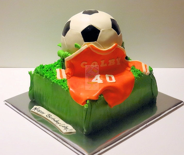 Soccer ball cake with jersey. 