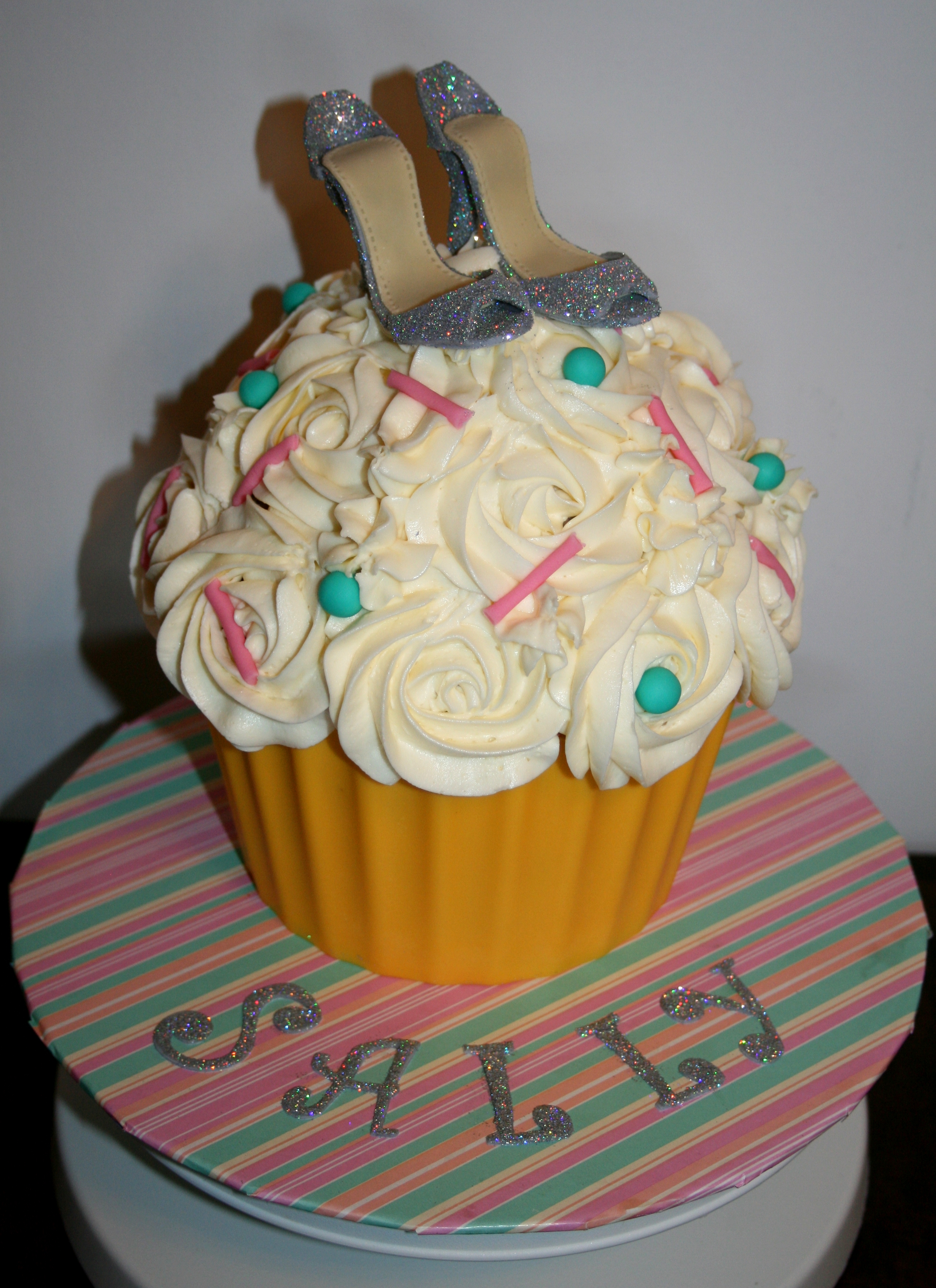 Giant Vanilla Cupcake with handmade gumpaste shoes. Base is wilton yellow candy melts, thanks for looking!