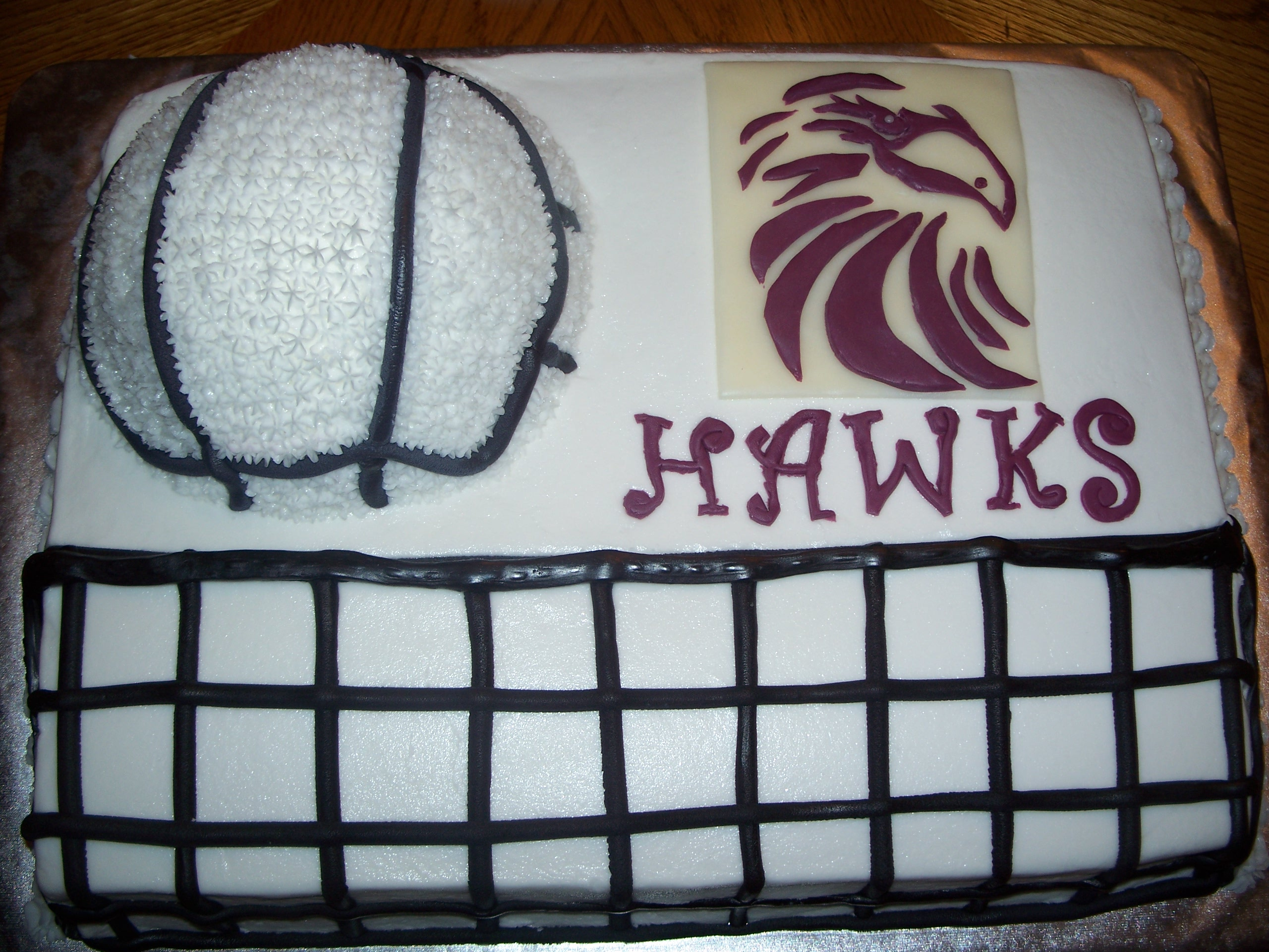 Vanilla cake with vanilla buttercream and fondant decorations.  Volleyball is half of the ball pan.