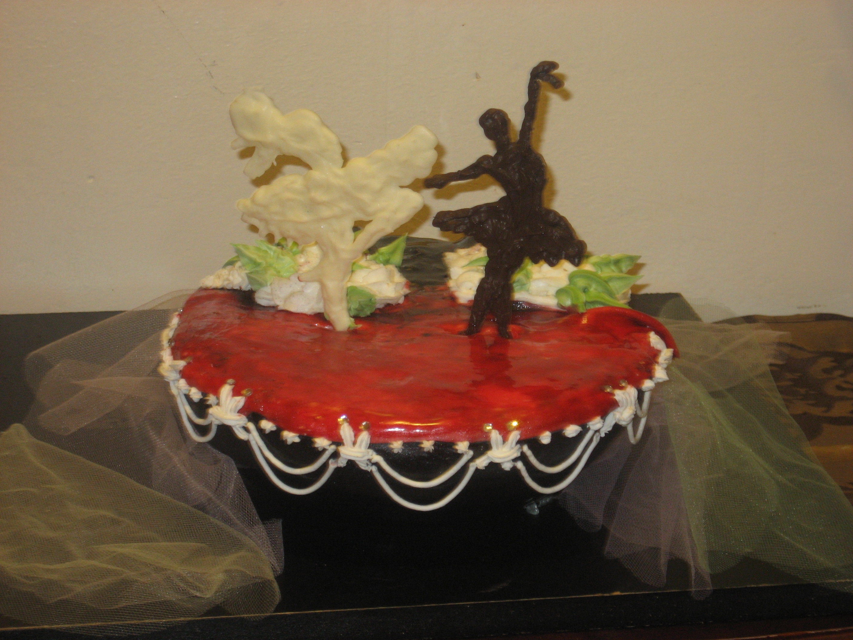 Dominican cake, with italian frosting, royal icing and Orance fondant, figures are made of chocolate