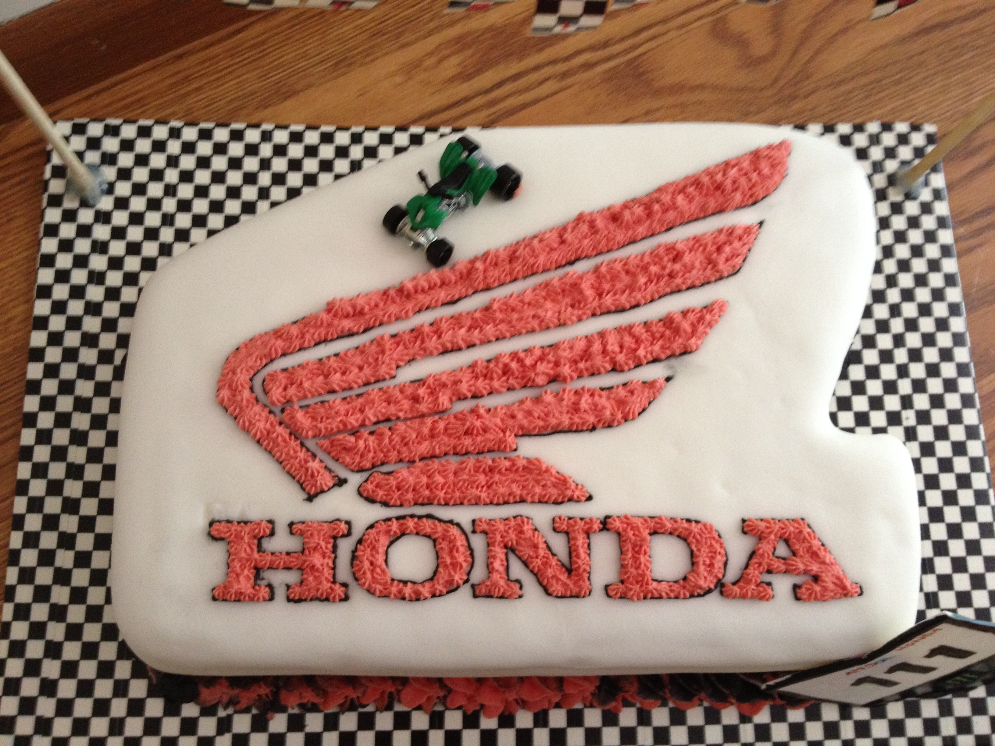 Friend of mine wanted a racing cake - He races a Honda four wheeler so I coudn't think of anything more perfect