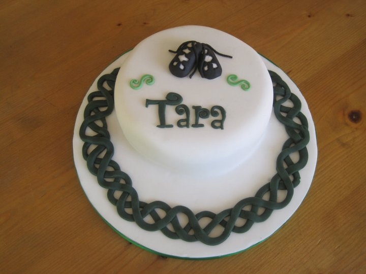 Celebration Cake for my cousin who has just passed her Irish Dancing teaching exams. The cake has a little pair of soft shoes on top with cutouts, just like an Irish Dancer would wear. The Celtic pattern was taken from a frequently used Celtic circle...