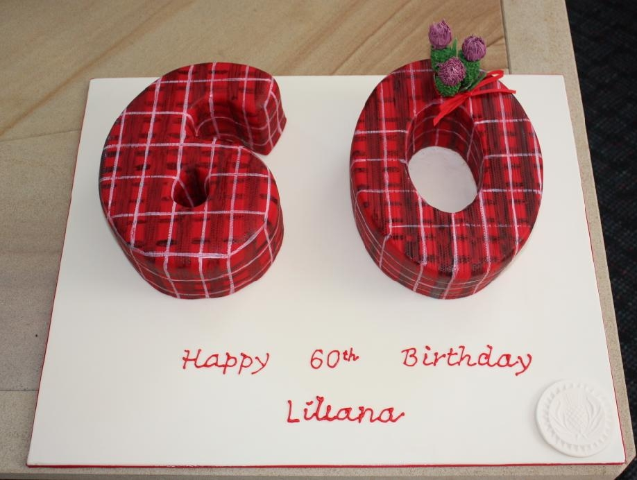 Made for a friend's 60th birthday who loves her highland dancing.  I didn't know the best way to do a tartan pattern, so just painted it on freehand.  Once you paint the black on, it's on for good!  It ended up a bit rough.  The thistles were made...
