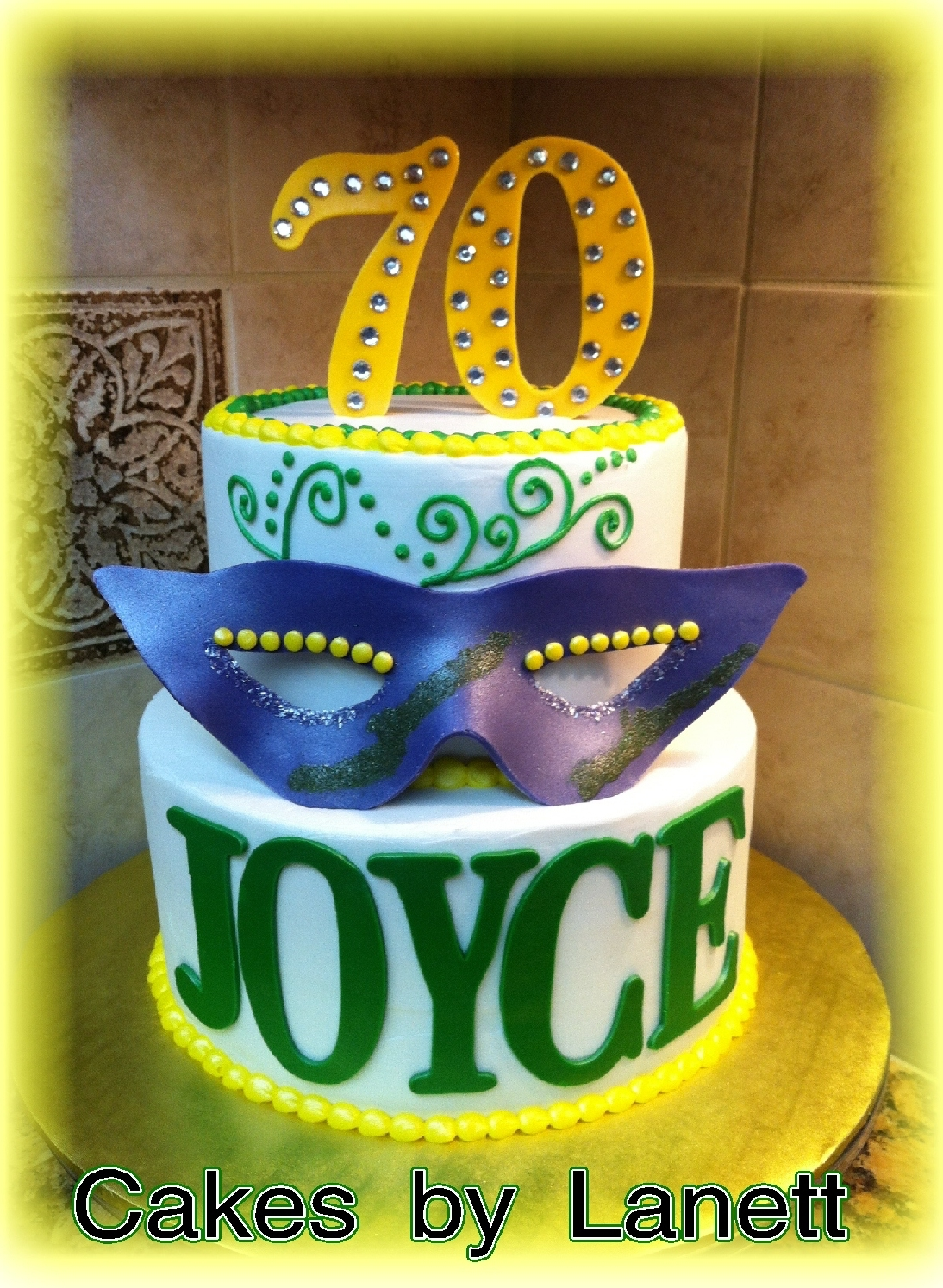 tiered mardi gras theme cake with mask