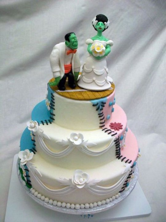 The cake is decorated to look like a Frankensteinian combination of a wedding cake, a birthday cake, and a flowery spring cake.  The topper features my first ever gum paste figures.
