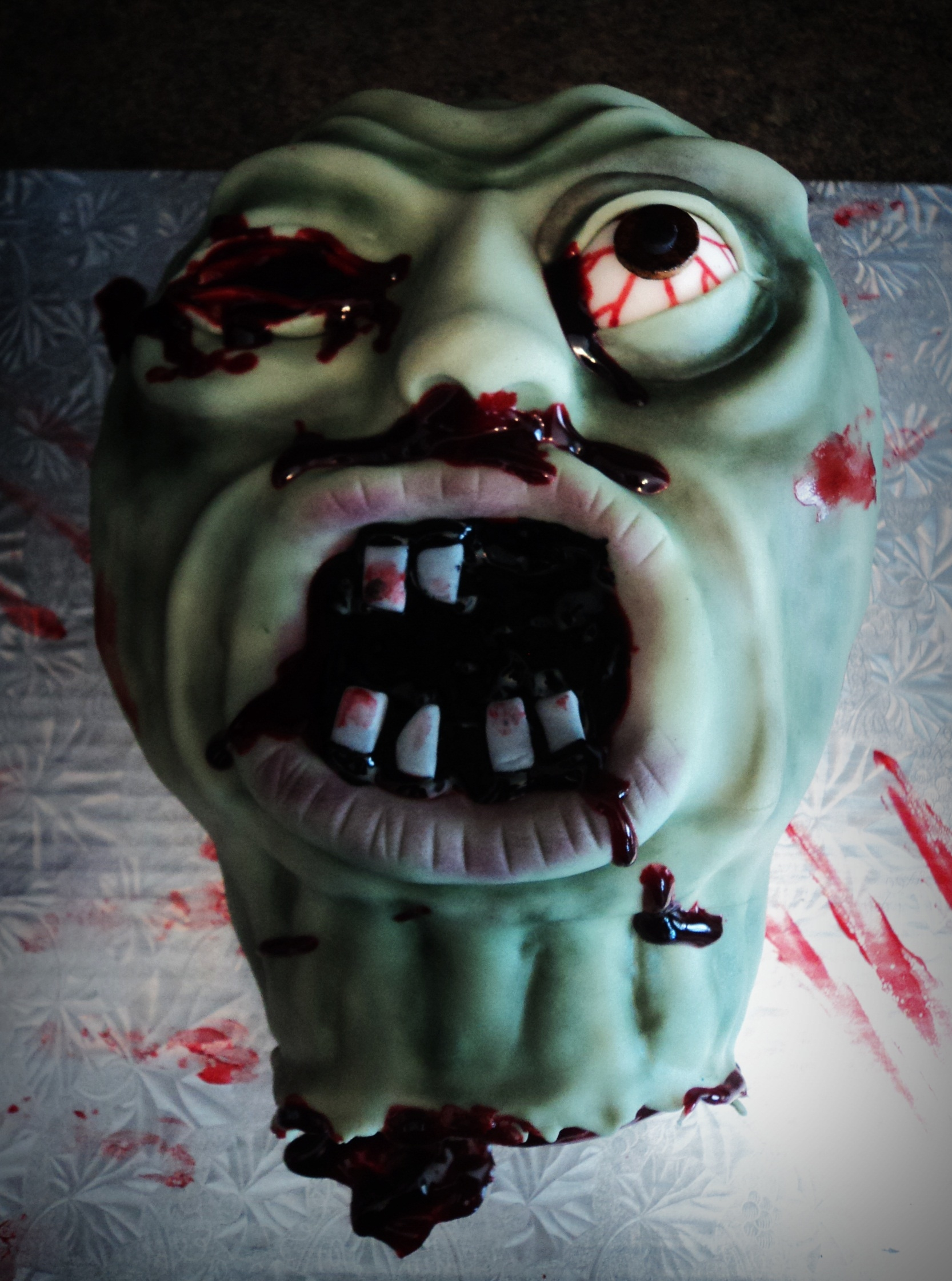 zombie cake!  Marble cake with vanilla buttercream. Blood is piping gel and gel colouring.