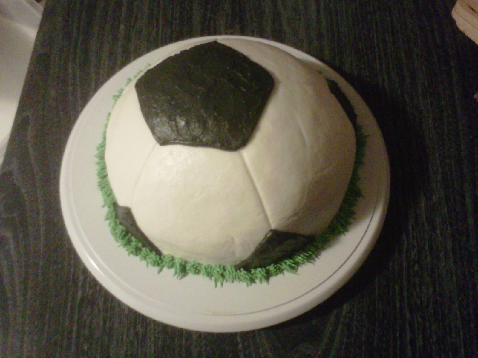 "My nephew wanted a soccer ball cake for his birthday and I was happy to do it. It left my house all nice as you can see. About ten minutes into our 3 hour car ride one of my kids says,""Mom, your cake is falling on one side"" so with some quick..."