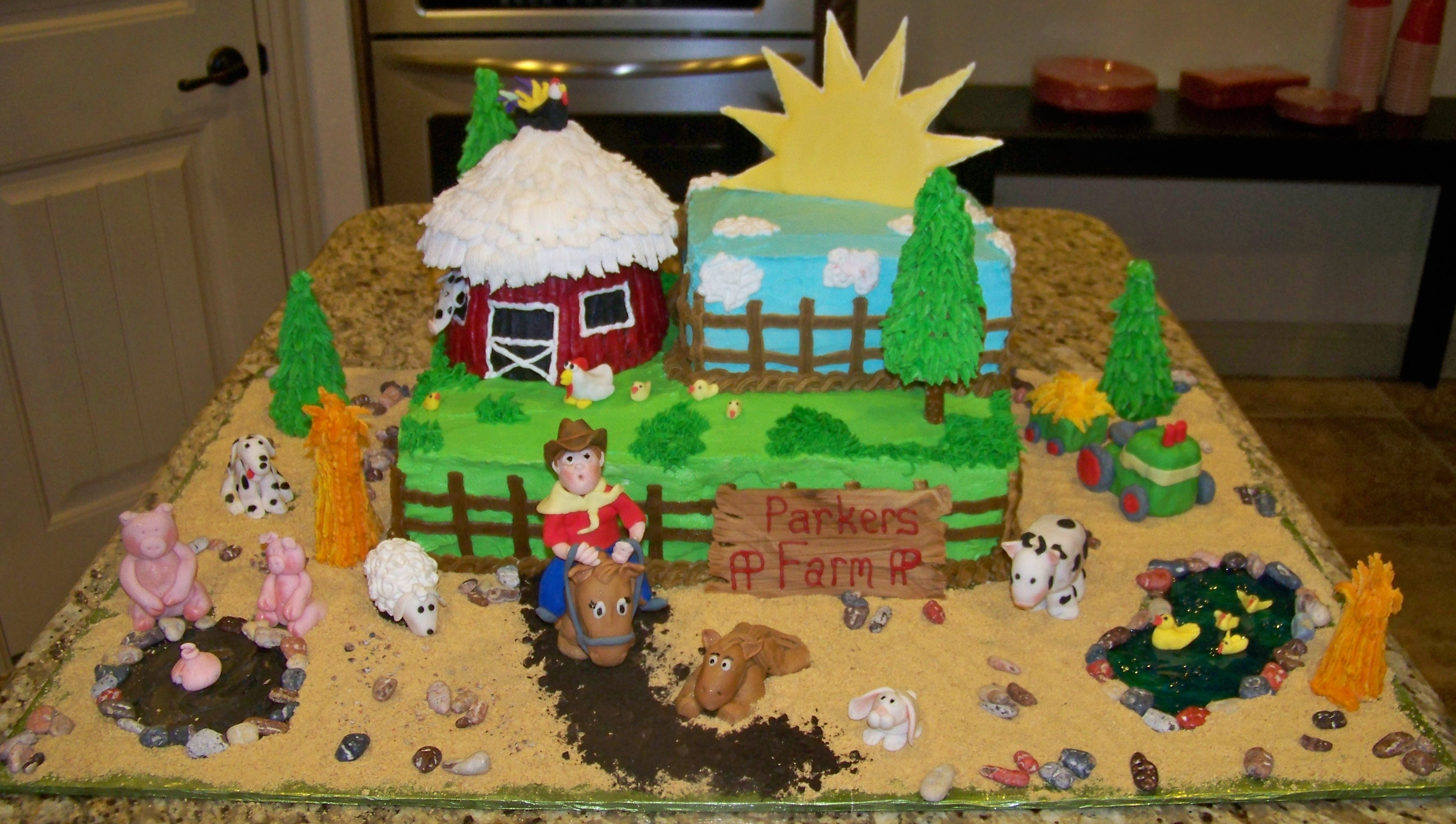 Farm scene with fondant farm animals, a little boy sitting on a horse, barn and a large colorflow sun.