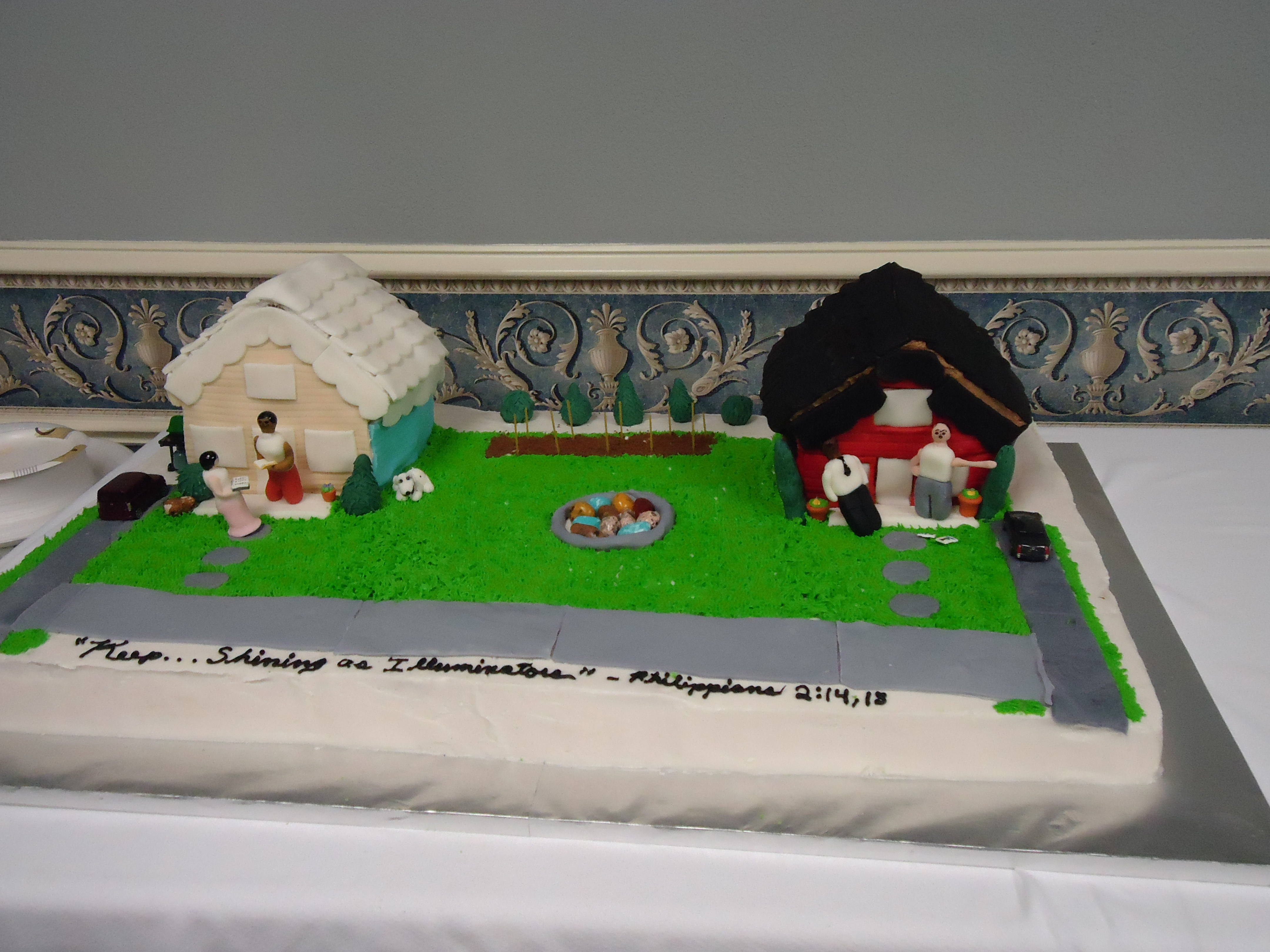 Cake depicting the good and bad experiences of preaching from house to house as one of Jehovah's Witnesses. The room was so hot from the chafing dishes of the other food that the fondant starting sliding off the cake and my figures kept falling over....