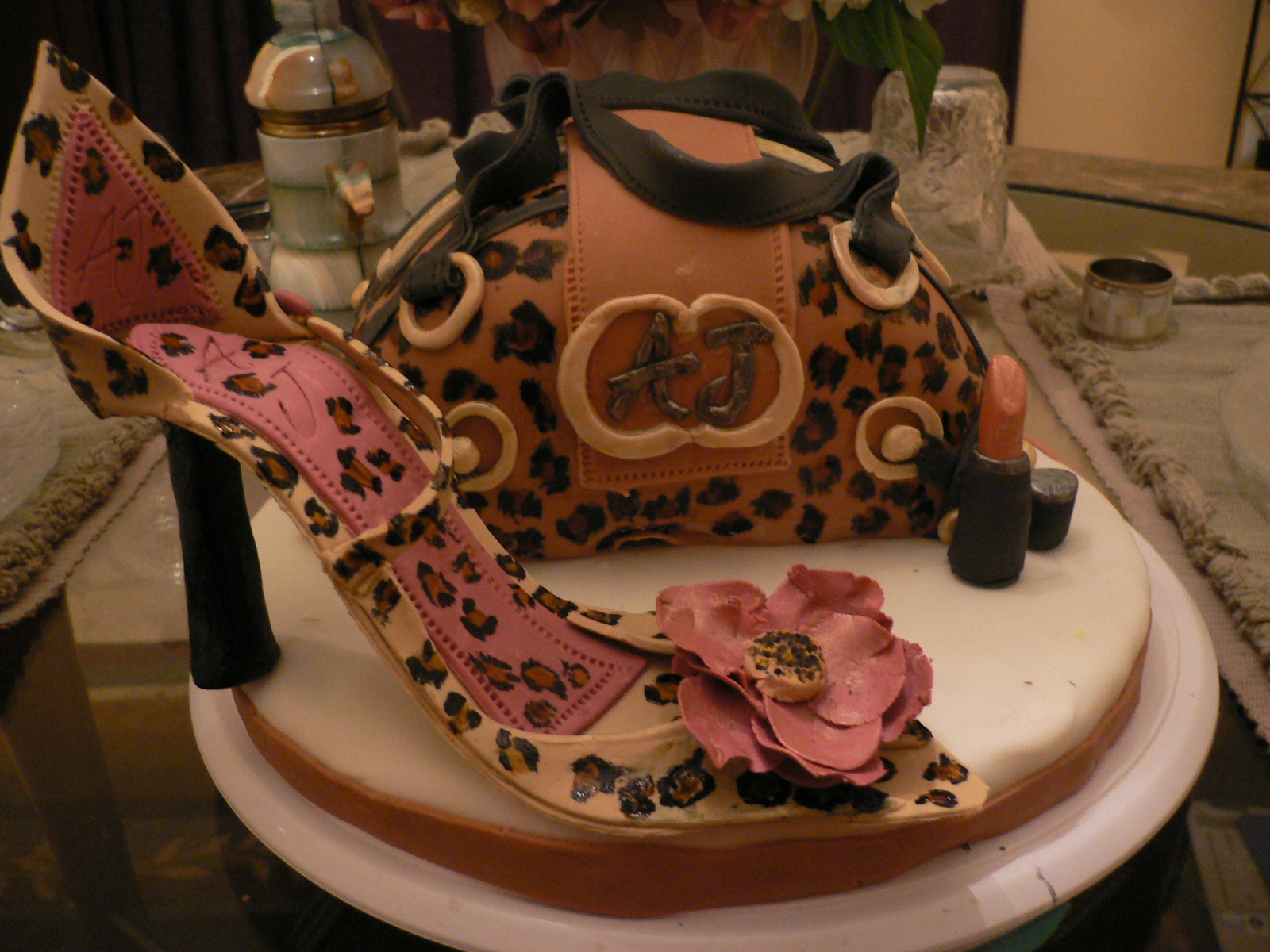 My 1st purse cake, gum paste shoe and lipstick. I LOVE Leopard print. Also, there is  leopard print  on top, the bottom & inside too! Took me 16 hrs to make, but I had fun and I learned through trial and error. My luster dust painting isn't up to par and it didn't come out as a deep gold (which I was looking for). Inside Leopard Print Tutorial: http://artesecakes.blogspot.com/2012/07/leopard-print-inside-cake-tutorial.html