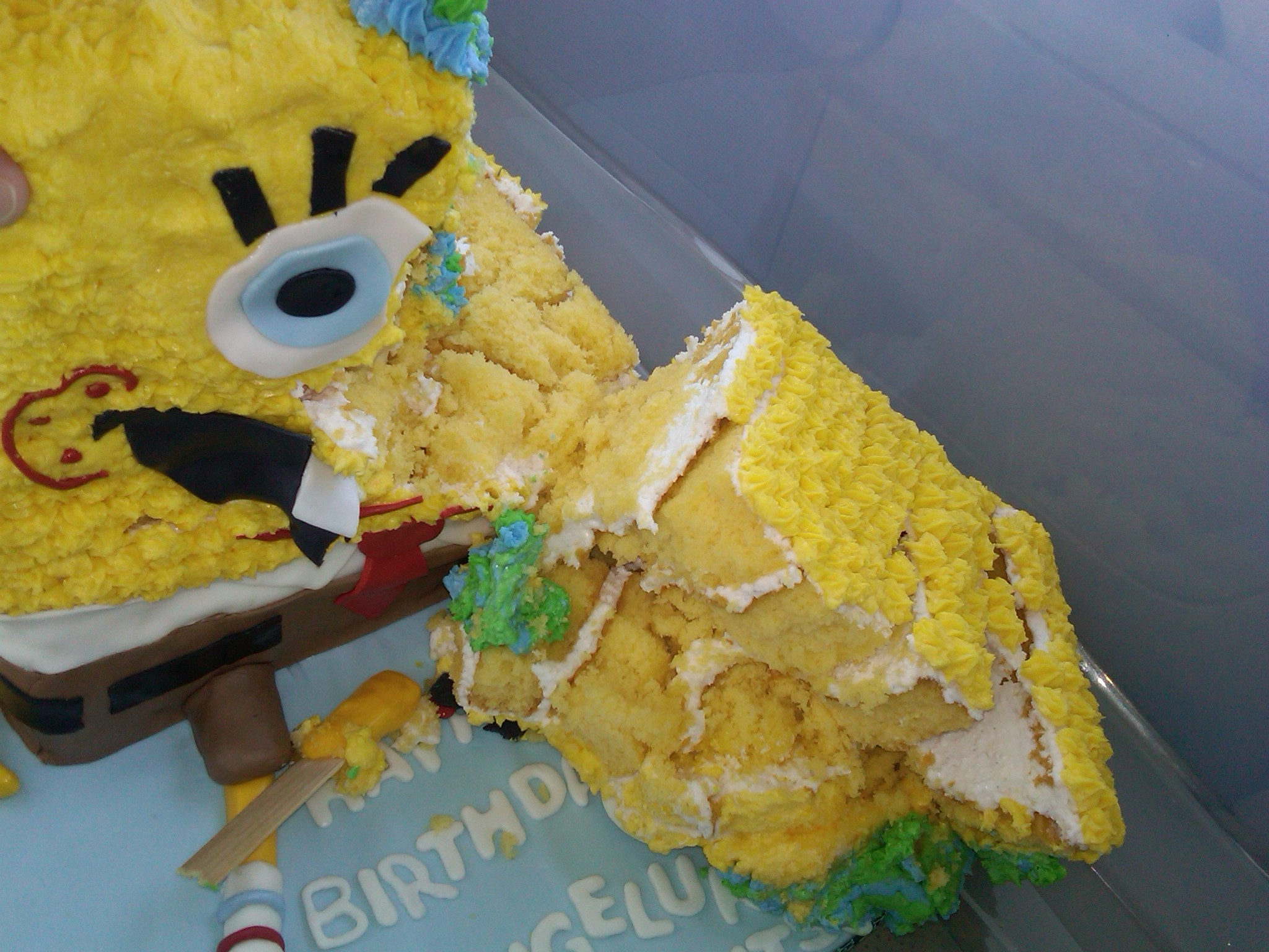 Poor Spongebob... this cake was a nightmare.  It fell apart on the way to deliver it.  The vibration from the truck and the fact that I only used a dowel in the center of the cake (rookie mistake) this one fell quick.  Noted use more than one dowel... luckily it was not needed until the next day... so we got a redo on this one! Here is before and after pictures.